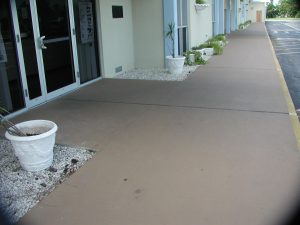 Front entrance to a building that has been finished with ReCoat by Renew Crete
