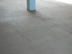 Simple concrete with a post in the middle that has been finished with ReCoat by Renew Crete