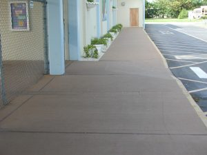 Sidewalk finished with a brown hue of ReCoat