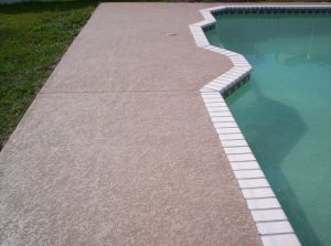 Simple pool deck with a white tile border