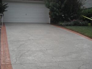 Concrete driveway finished with a Spray Coat application by Renew Crete
