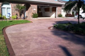 Spray coat driveway leading to an open garage
