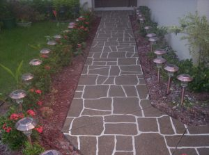 A narrow pathway leading a front door that has been stenciled and then restored with Spray Coat