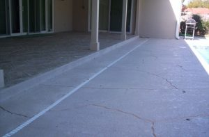 A pool deck that has been prepped for spray coat by Renew Crete Systems